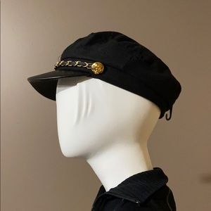 Black felt cap with gold and black leather accents